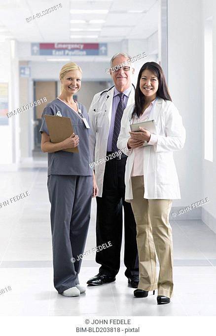 Doctors and nurse smiling in hospital