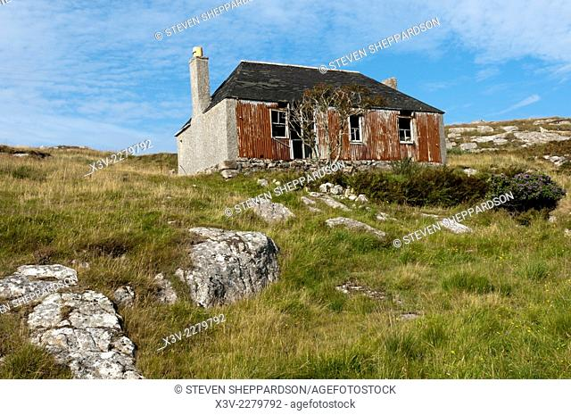 Europe, UK, Scotland, Outer Hebrides, Scalpay - semi-derelict house partially constructed of corrugated iron