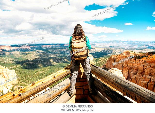 Women hiker with backpack on a lookout in Bryce Canyon, Utah, USA