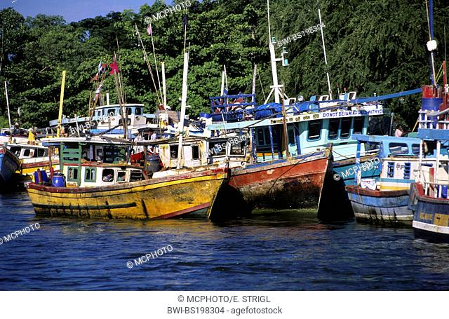 old fishing boats in the harbor of Negombo, Sri Lanka
