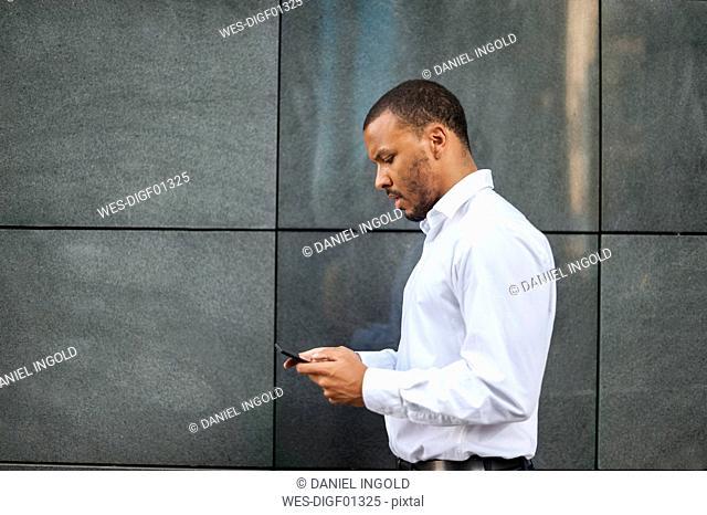 Businessman using phablet
