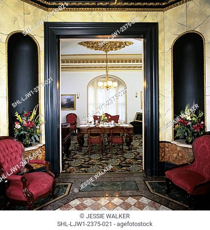 entry hall: victorian, view of dining room, marbleized walls, floral arrangements in alcoves, patterned marble floor, upholstered Belter side chairs