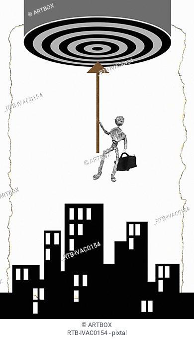 Figurine of a man holding an arrow above buildings