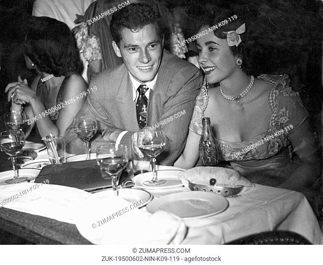 June 2, 1950 - Paris, France - An iconic two-time Academy Award-winning British-American actress ELIZABETH 'LIZ' TAYLOR with the hotel heir NICKY HILTON that...