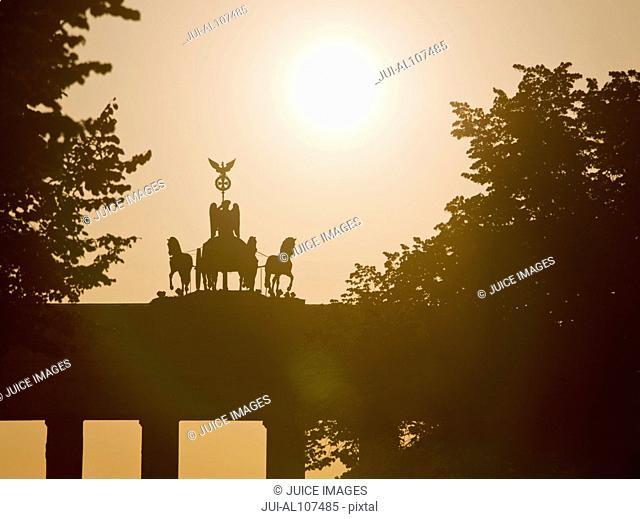 Brandenburg Gate with Quadriga in backlight, Berlin, Germany