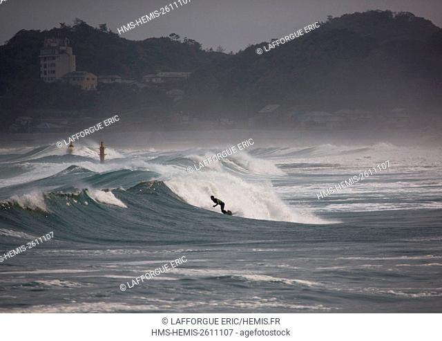 Japan, Fukushima Prefecture, Tairatoyoma Beach, japanese surfer in the contaminated area after the daiichi nuclear power plant irradiation
