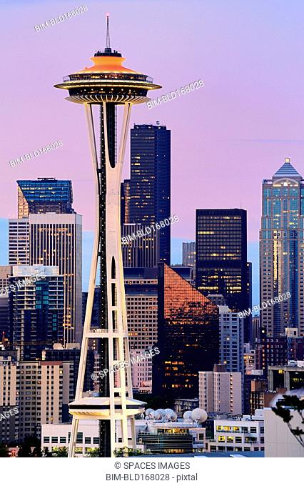 Space Needle and high rise buildings in Seattle city skyline at sunset, Washington, United States
