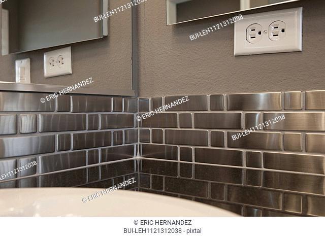 Metallic backsplash in bathroom; Murrieta; California; USA