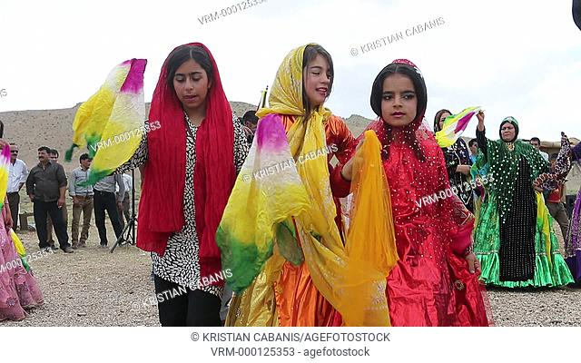 Nomad people dancing during a wedding procession, Fars region, Iran, Asia