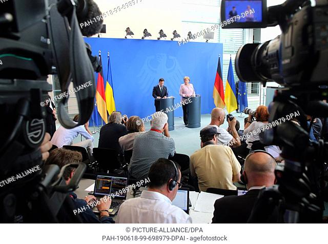 18 June 2019, Berlin: Federal Chancellor Angela Merkel (CDU) and Volodymyr Selensky, President of Ukraine, answer questions from journalists at the Federal...