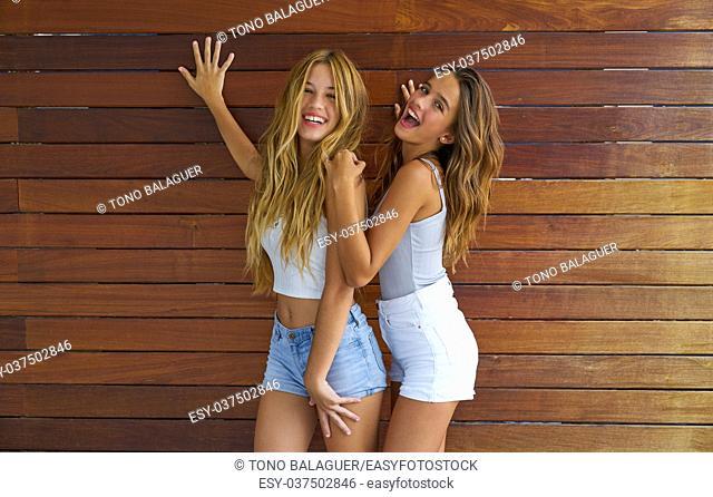 Best friends teen girls happy having fun together