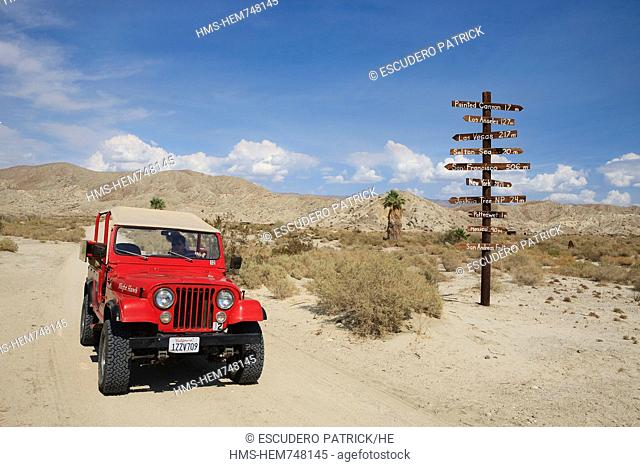 United States, California, Palm Springs, jeep and sign in the Colorado desert on the San Andreas fault, Coachella valley