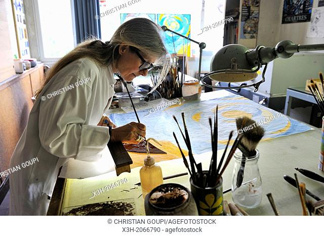 artist Valerie Gaugeac working on stained glass window at Ateliers Loire at Leves, around Chartres, Eure & Loir department, region Centre, France, Europe