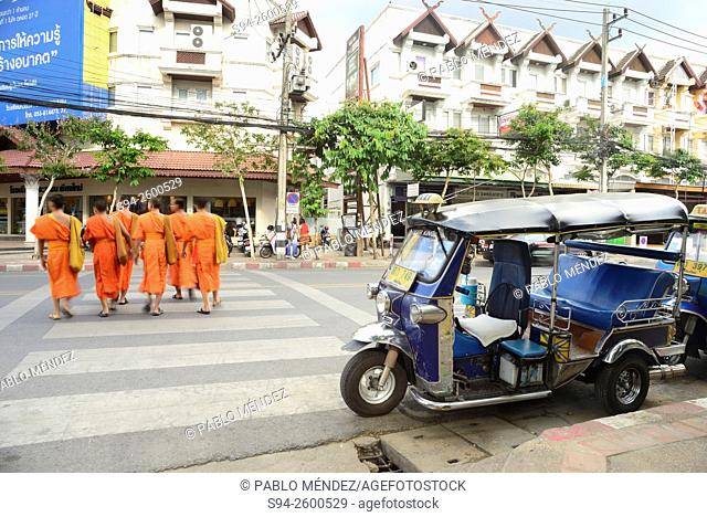 Monks crossing. Tuk-Tuk in a street of Chiang Mai, Thailand