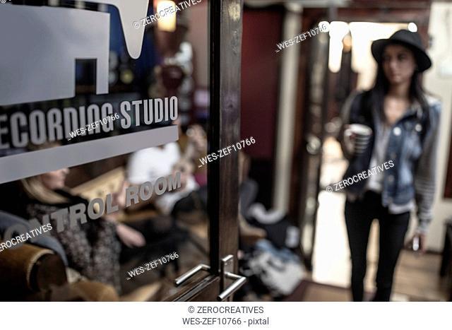 Female musician entering recording studio