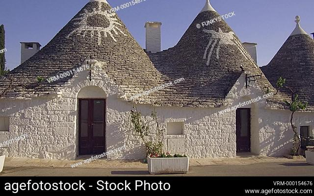 Alberobello, Apulia, Italy : zoom in to close up of sun symbol painted on a conical beehive shaped roof of the stone built historical trullo traditional of...