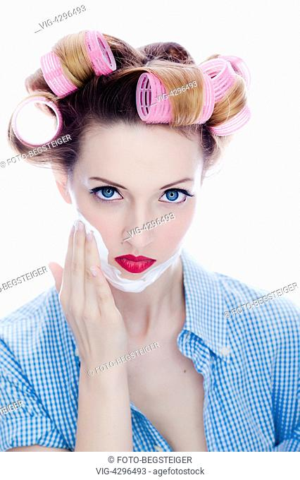 woman with hair roller and shaving foam in the face - , 11/03/2014
