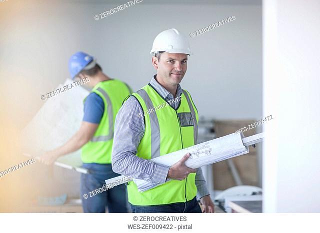 Confident architect on construction site