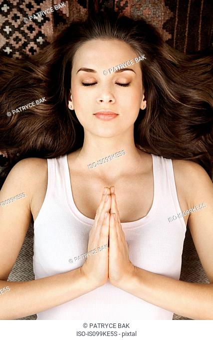 Young woman in prayer pose