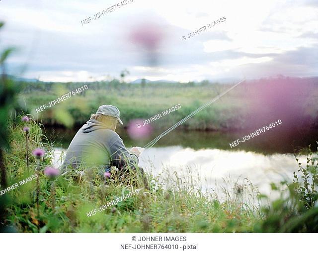 A man fishing in a stream