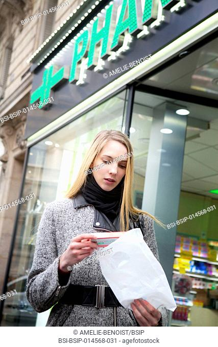 Woman coming out of a pharmacy