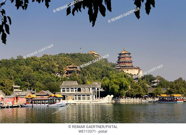 Marble Boat among other ferries on Kunming Lake with Buddhist Fragrance Pavilion on Longevity Hill Summer Palace Beijing