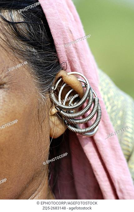 Close up of a Bhil tribal women wearing traditional Pawra jewelry