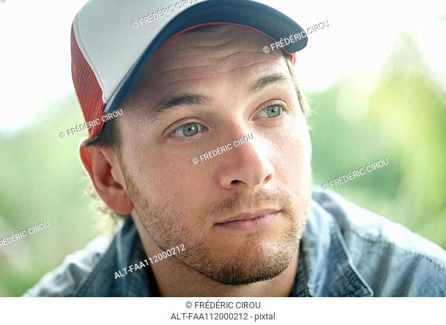 Man wearing baseball cap, portrait