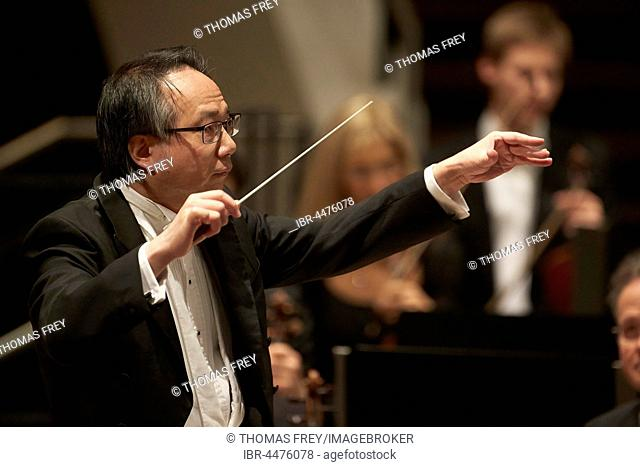 Conductor Shao-Chia Lü conducting at concert, Rhein-Mosel-Halle, Koblenz, Rhineland-Palatinate, Germany