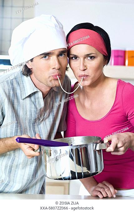 couple cooking spaghetti