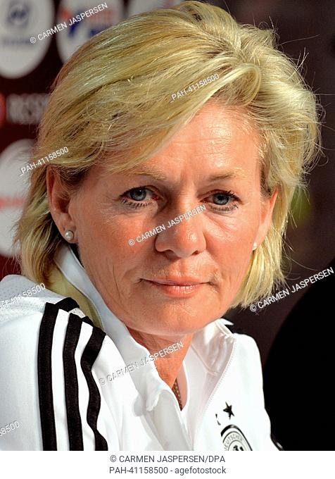 Germany's head coach Silvia Neid smiles during a EUFApress conference for the UEFAWomen's Euro in the press room at Vaxjo Arena in Vaxjo, Sweden, 20 July 2013