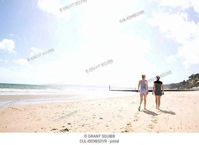 Sisters walking on beach