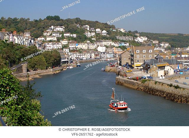England, Cornwall, Looe, entrance to harbour, fishing boat departing