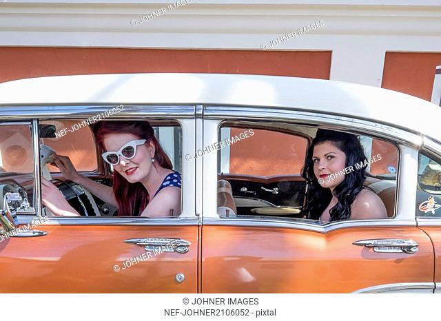 Women in vintage car