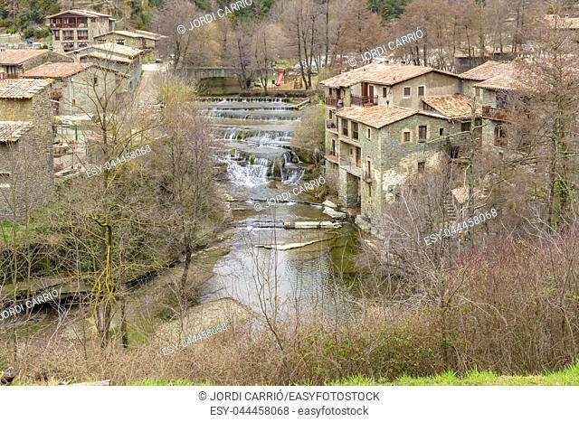 Set of waterfalls of the river Rupit as it passes through the medieval town of Rupit, Catalonia, Spain