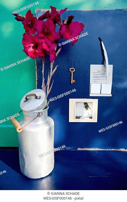 Mood board with personal stuff, milk churn and gladiolas