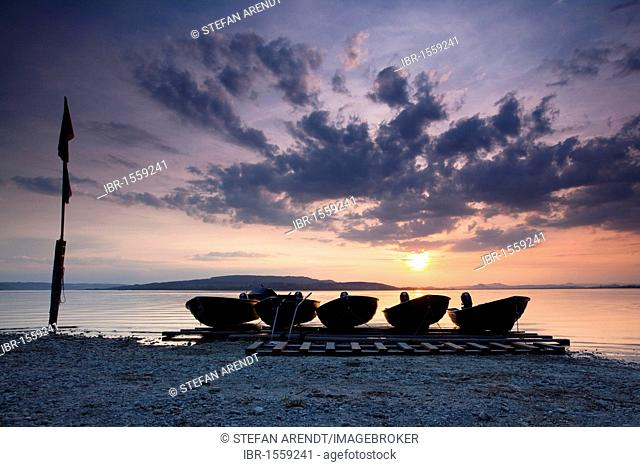 Boats in the evening light with sunset at Sandseele on Reichenau island
