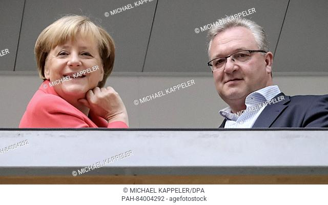 German Chancellor Angela Merkel (CDU) speaking to Berlin CDU prime candidate Frank Henkel before the start of the CDU party executive meeting in Berlin, Germany