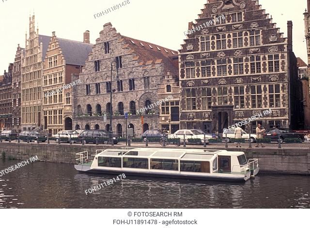 Ghent, Gent, Belgium, Oost-Vlaanderen, Europe, Medieval guild houses along the River Leie. Sightseeing tour boat along Gent's Graslei
