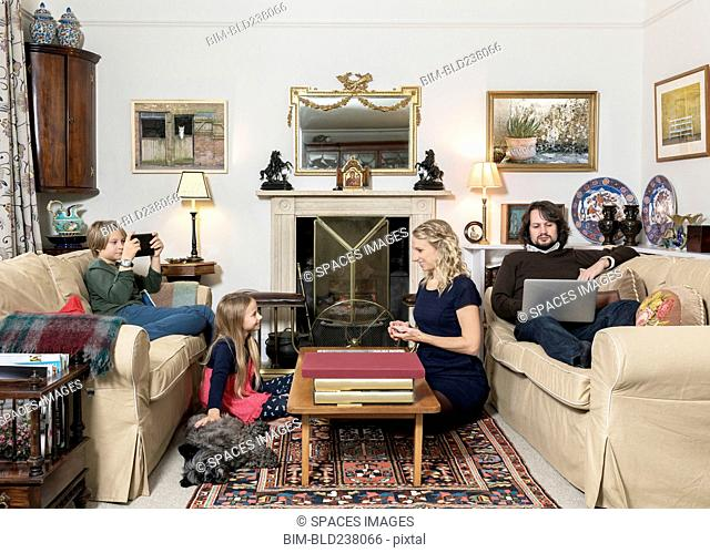 Caucasian family in livingroom