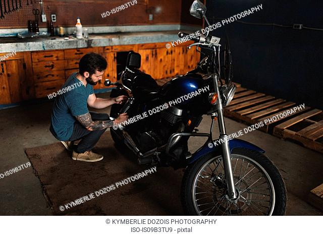 Man repairing bike in workshop