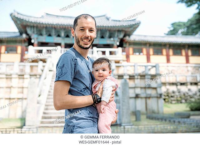 South Korea, Gyeongju, father traveling with a baby girl in Bulguksa Temple