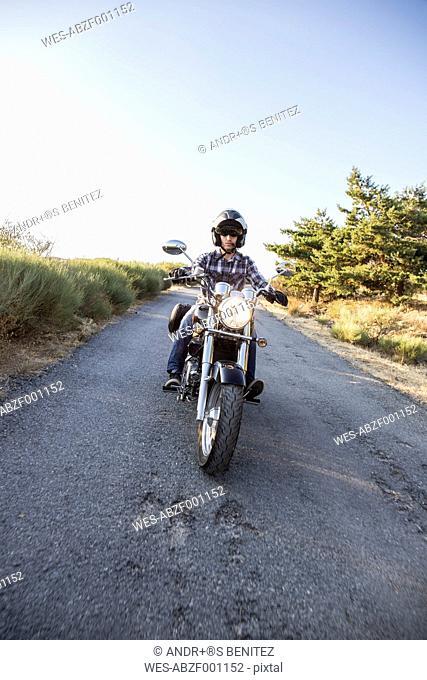 Man riding motorbike on open road