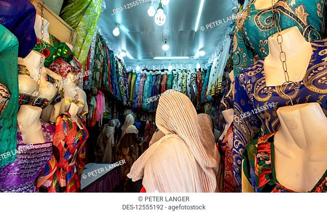 Eritrean woman at a clothing shop in the Mercato of the indigenous people; Asmara, Central Region, Eritrea