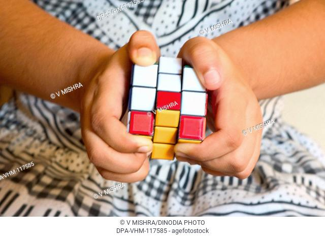 Concept ; hand playing with Rubik puzzle cube game MR201