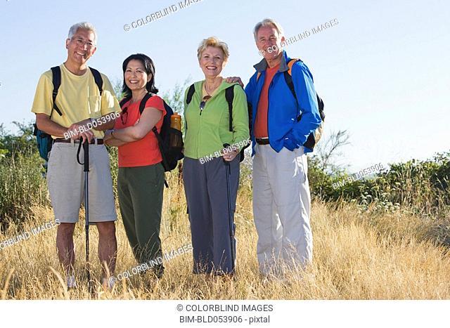 Multi-ethnic couples hiking