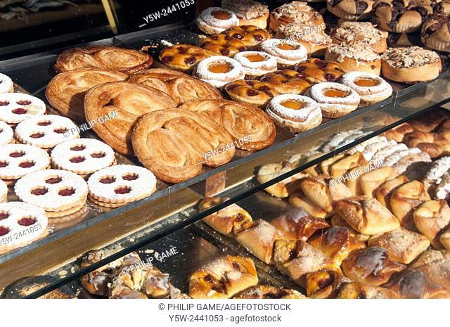 Cakes & pastries displayed in a bakery shop window in Glen Huntly Road, Elsternwick, Melbourne, Australia