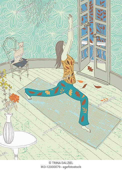 Woman doing yoga in lounge in autumn