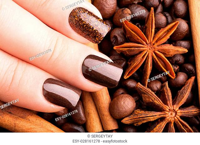 Beautiful brown nails close-up and coffee
