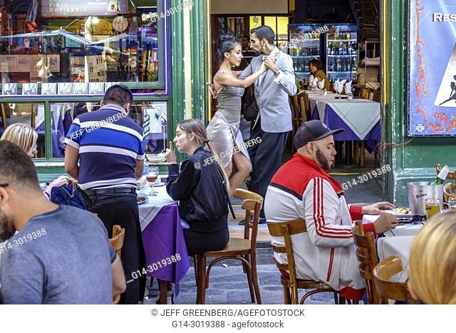 Argentina, Buenos Aires, Caminito Barrio de la Boca, La Vieja Rotiseria, restaurant, bar, tango show, man, woman, dancer, waiter, dining, Hispanic